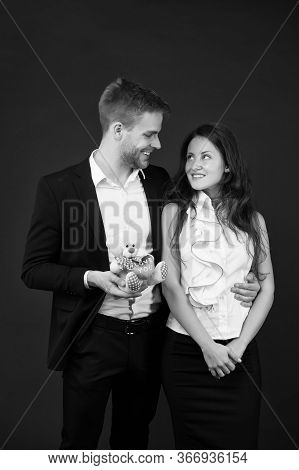 Feeling Happiness. Gift With Love. Couple On Romantic Date. Formal Couple With Toy Bear. Joint Busin