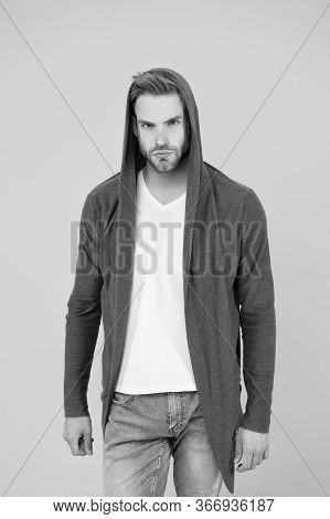 Handsome And Casual. Handsome Man Yellow Background. Young Guy Wear Hooded Sweatshirt. Handsome Mode