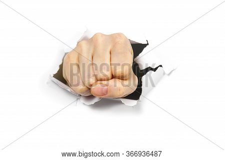 Punching Hole Through Paper Wall With Fist. Punch Break Through The Paper Wall. Fist Coming Out The