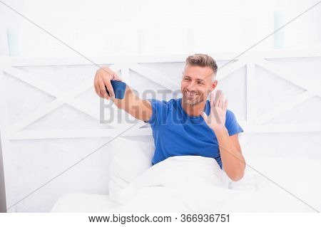 Online Communication. Mature Man Use Mobile Phone In Bed. Mobile Communication. Modern Life. Cellula