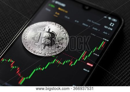 Bitcoin Silver Coin Cryptocurrency Trading On Smartphone Close Up