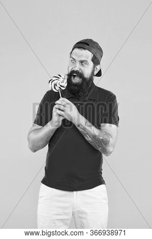 Who Cares About Diet. Bearded Man With Lollipop. Candy Shop Assistant. Sweet And Confectionary. Loll