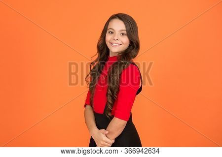 Healthy Smile. Feeling Lucky. Perfect Girl. Positive Emotions. Teen Girl Smiling Orange Background.