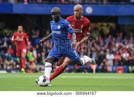 London, England - September 22, 2019: N\'golo Kante Of Chelsea (front) And Fabio Henrique Tavares (f