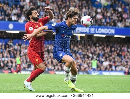 London, England - September 22, 2019: Mohamed Salah Of Liverpool (l) And Marcos Alonso Of Chelsea (r