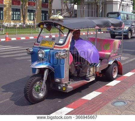 Bangkok Thailand 24th March 2019 Thai Traditional Taxi Known As Tuk Tuk With Its Driver In Bangkok,