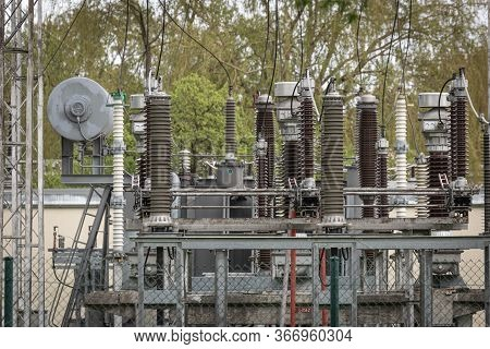 Low Angle View Of Electric Transformer In Power Station. Reactor Pressure To Maintain A Constant Ele