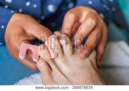 Close Up Of A Senior Woman Foot While Getting A Pedicure At Home During Covid-19 Pandemic