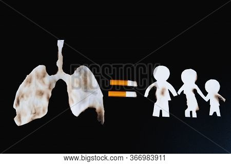 Paper Cut Of Family Members Destroyed By Cigarette On Black Background. Smoking Destroying Family Co