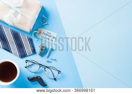 Happy Fathers Day Background Concept With Blue Necktie, Gift Box And The Text