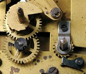 A close up view with a watch mechanism poster