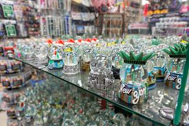 New York, United States - September 20, 2019: Collection Of Crystal Snow Balls For Sale In A Souveni