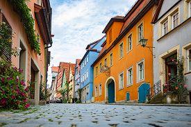 Empty Old Street In Rothenburg Ob Der Tauber, Bavaria, Germany, Europe. Old German Architecture. Blu
