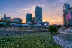 Seoul, South Korea - Jun 29, 2018 : Seoul City Skyline At Sunset With Beautiful Led Rose Field At Do