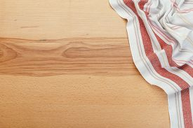 Top View On A Wooden Table With A Linen Kitchen Towel Or Textile Napkin.