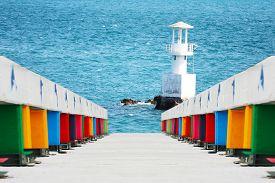 Rainbow Bridge And Lighthouse On The Coast And Blue Sea