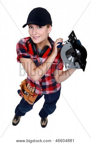 Woman holding circular saw