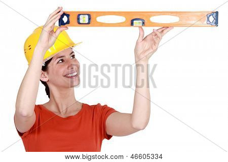 Woman holding spirit level poster