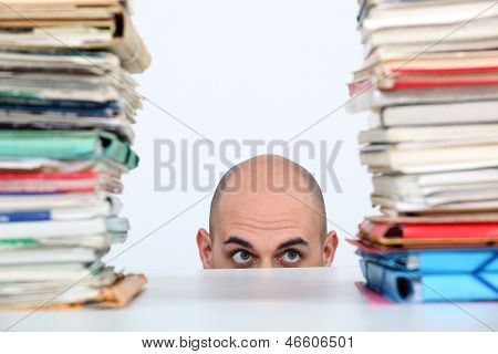 Man peeking through stacks of folders poster