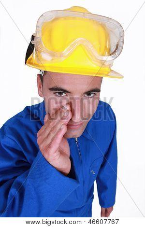 Worker wearing blue boiler suit