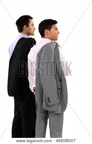 Two businessmen with their jackets over their shoulders poster