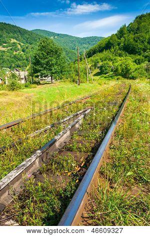 Railway Sneaking Through Mountain Near The Wilage