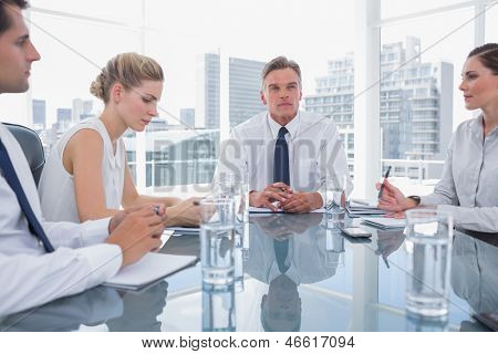 Serious businessman during a meeting with his employees