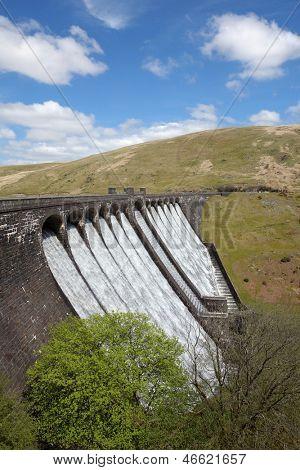 The Claerwen reservoir dam overflowing, Elan Valley Wales UK.