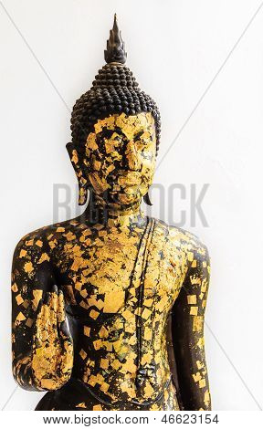 Black Buddha Statue Covered With Small Gold Plates Isolated On White Background