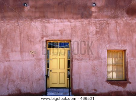 Pink And Yellow Adobe House