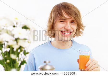 Young man drinking juice
