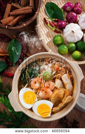 Prawn noodles, prawn mee. Famous Malaysian food har mee spicy fresh cooked in clay pot with hot steam.