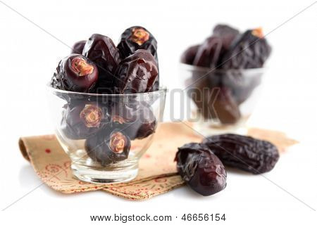 Dates fruit. Pile of fresh dried date fruits in glass isolated on white background.