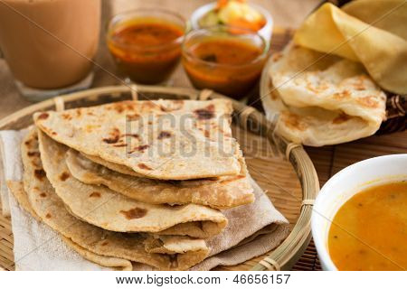 Indian food, Chapati flatbread, roti canai, dal, curry, teh tarik or pulled tea, acar. Famous indian cuisine. poster