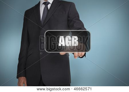 Businessman touching the word agb on blue background