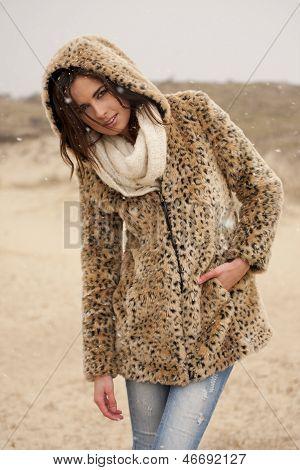 Beautiful Woman Wearing Tigerprint Coat In Snow