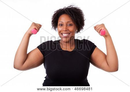 Portrait Of A Black Fatty Woman Working Out With Free Weights - African People