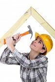 Tradeswoman hammering a frame poster