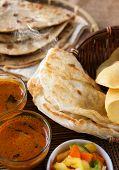 Indian meal, Chapati flatbread, roti canai, dal, curry, teh tarik or pulled tea, acar. Famous indian food. poster