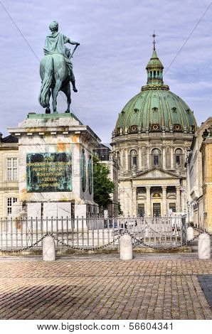 Castle Amalienborg with statue of Frederick V in Copenhagen, Denmark. The castle is the winter home of the Danish royal family