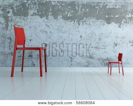 Huge and small chair standing against each other