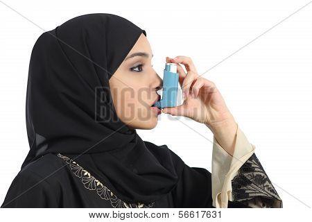 Saudi Arabian Woman Breathing From An Asthma Inhaler