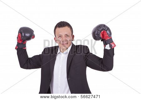Portrait of a businessman with boxing gloves flexing biceps