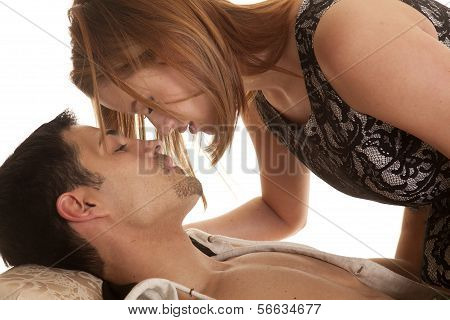 Couple Lay Woman Over Man About To Kiss