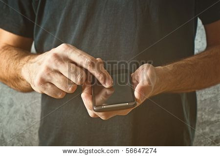 Man Typing Text Message On His Smart Phone, Selective Focus