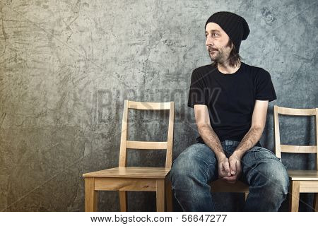 Man Sitting On Wooden Chair And Waiting