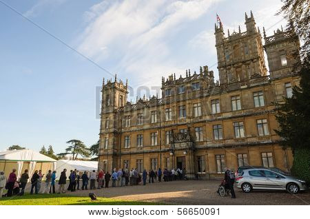 NEWBURY, UK - CIRCA OCTOBER 2011: People  queuing to visit Highclere Castle which  is the main setting for the ITV period drama Downton Abbey.