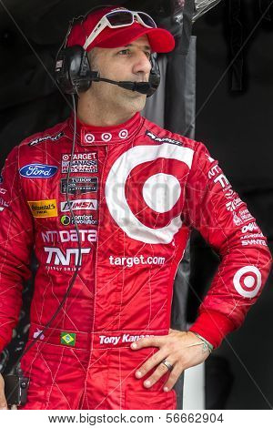 Daytona Beach, FL - Jan 04, 2014:  Driver, Tony Kanaan, watches his crew work during the Roar Before the Rolex 24 at Daytona International Speedway in Daytona Beach, FL.