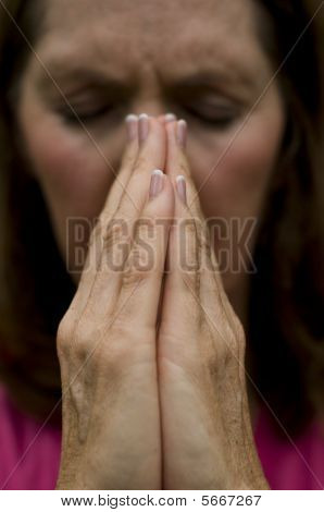 Woman With Hands Together As If Praying