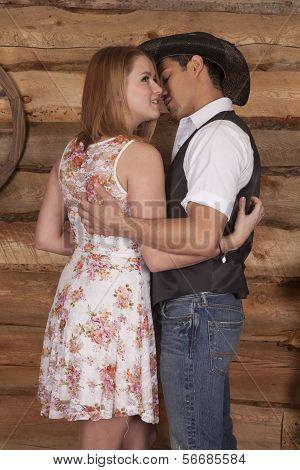 Cowboy With Woman In Arms Hug